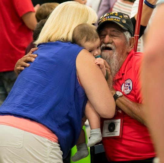 Florentino Martinez, a Korean War veteran, is greeted at Southwest Florida International Airport as he returns from the Collier - Lee Honor Flight trip to Washington DC on Saturday, September 29, 2018.
