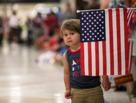 Logan Keller, 2, waits for veterans on the Honor Flight to arrive back home at Southwest Florida International Airport on Saturday.