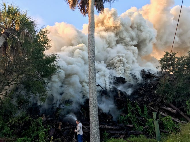 Workers battled flames at MW Horticulture Saturday in North Fort Myers.