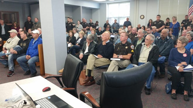 About 20 Door County deputies in uniform and others packed the County Board meeting Thursday to discuss a proposal to reclassify jailers as non-protective service employees. The deputies opposed the measure, which the County Board defeated.