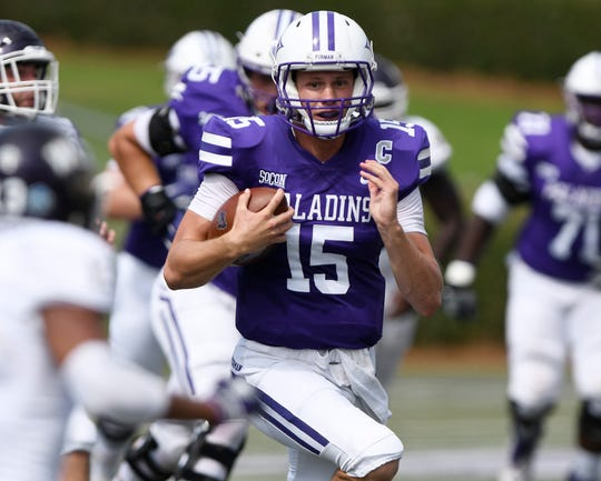Furman quarterback Harris Roberts (15) reels off a huge gain against Western Carolina.
