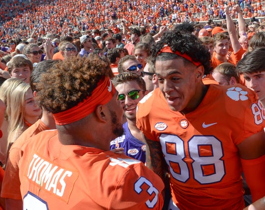 Clemson defensive lineman Xavier Thomas (3) celebrates with teammate tight end Braden Galloway (88) after a 27-23 win over Syracuse after the game in Memorial Stadium on Saturday, September 29, 2018.