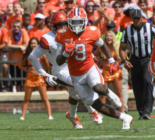 Clemson running back Travis Etienne (9) runs against Syracuse during the third quarter in Memorial Stadium on Saturday, September 29, 2018.