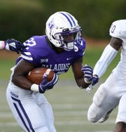 Furman tailback Devin Wynn (22) rushes against Western Carolina.