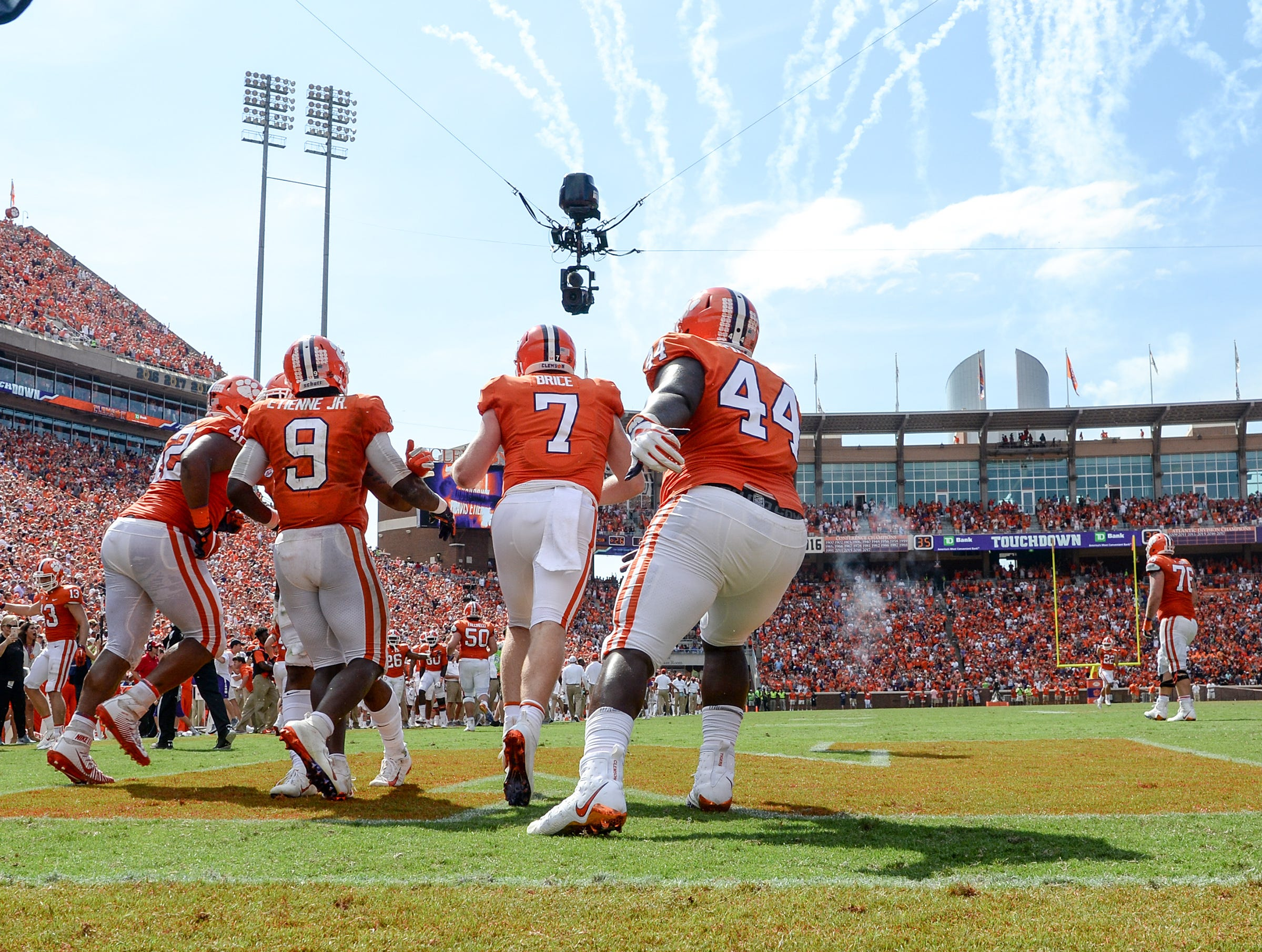 Clemson running back Travis Etienne (9) celebrates with teammates after the go-ahead touchdown against Syracuse during the fourth quarter in Memorial Stadium on Saturday, September 29, 2018.