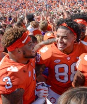 Clemson tight end Braden Galloway (88) and defensive lineman Xavier Thomas (3) celebrate a 27-23 win over Syracuse after the game in Memorial Stadium on Saturday, September 29, 2018.