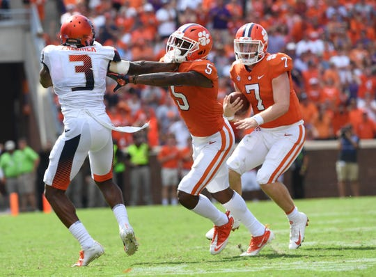 Clemson quarterback Chase Brice (7) runs for 17 yards against Syracuse for a first down during the fourth quarter in Memorial Stadium on Saturday, September 29, 2018.