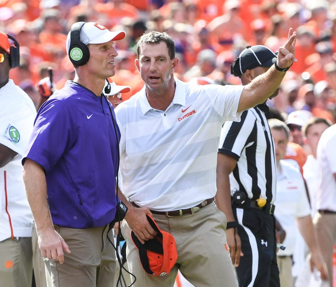 Clemson Head Coach Dabo Swinney talks with Defensive Coordinator Brent Venables late during the fourth quarter in Memorial Stadium on Saturday, September 29, 2018.