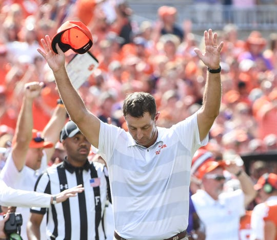 Clemson Head Coach Dabo Swinney holds his hands up after a referee calls a penalty against Syracuse late during the fourth quarter in Memorial Stadium on Saturday, September 29, 2018.
