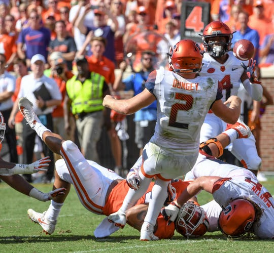 Clemson defensive lineman Xavier Thomas (3) gets a grip on Syracuse quarterback Eric Dungey(2) throwing the ball in the closing seconds during the fourth quarter in Memorial Stadium on Saturday, September 29, 2018.