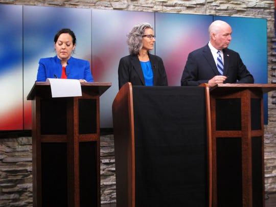 From left, Libertarian Elinor Swanson, Democrat Kathleen Williams and Republican U.S. Rep. Greg Gianforte wait for a Montana U.S. House debate to begin on Saturday, Sept. 29, 2018, in Helena, Mont. (AP Photo/Matt Volz)