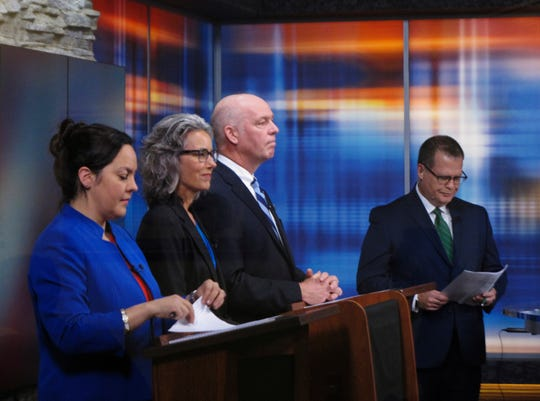 From left, Libertarian Elinor Swanson, Democrat Kathleen Williams and Republican U.S. Rep. Greg Gianforte listen to introductory remarks before a debate for Montana's U.S. House seat on Saturday, Sept. 29, 2018, in Helena, Mont. (AP Photo/Matt Volz)