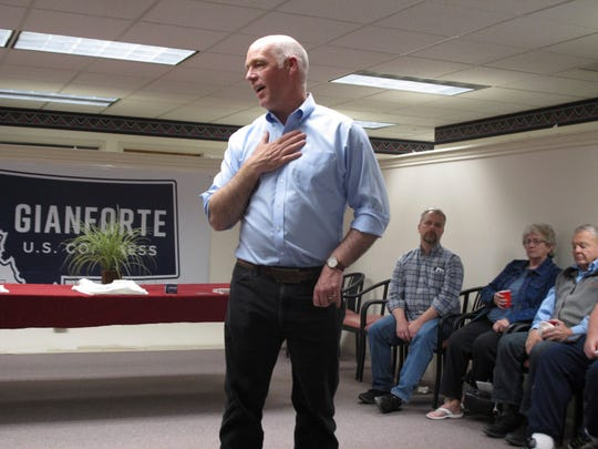 In this Sept. 21, 2018, photo, U.S. Rep. Greg Gianforte, R-Montana, speaks at a campaign rally in Helena, Mont. Gianforte is facing Democratic challenger Kathleen Williams and Libertarian candidate Elinor Swanswon in a debate Saturday night, Sept. 29. (AP Photo/Matt Volz)