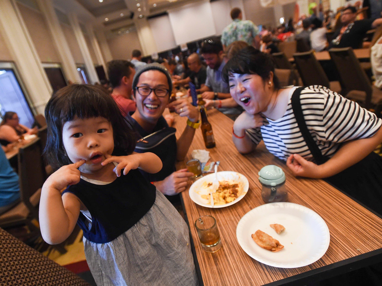 Two-year-old Maiko Kawasaki poses beside parents Yuta and Emiko Kawasaki during the Circle K Craft Beer Festival at the Sheraton Laguna Guam Resort, Sept. 29, 2018.