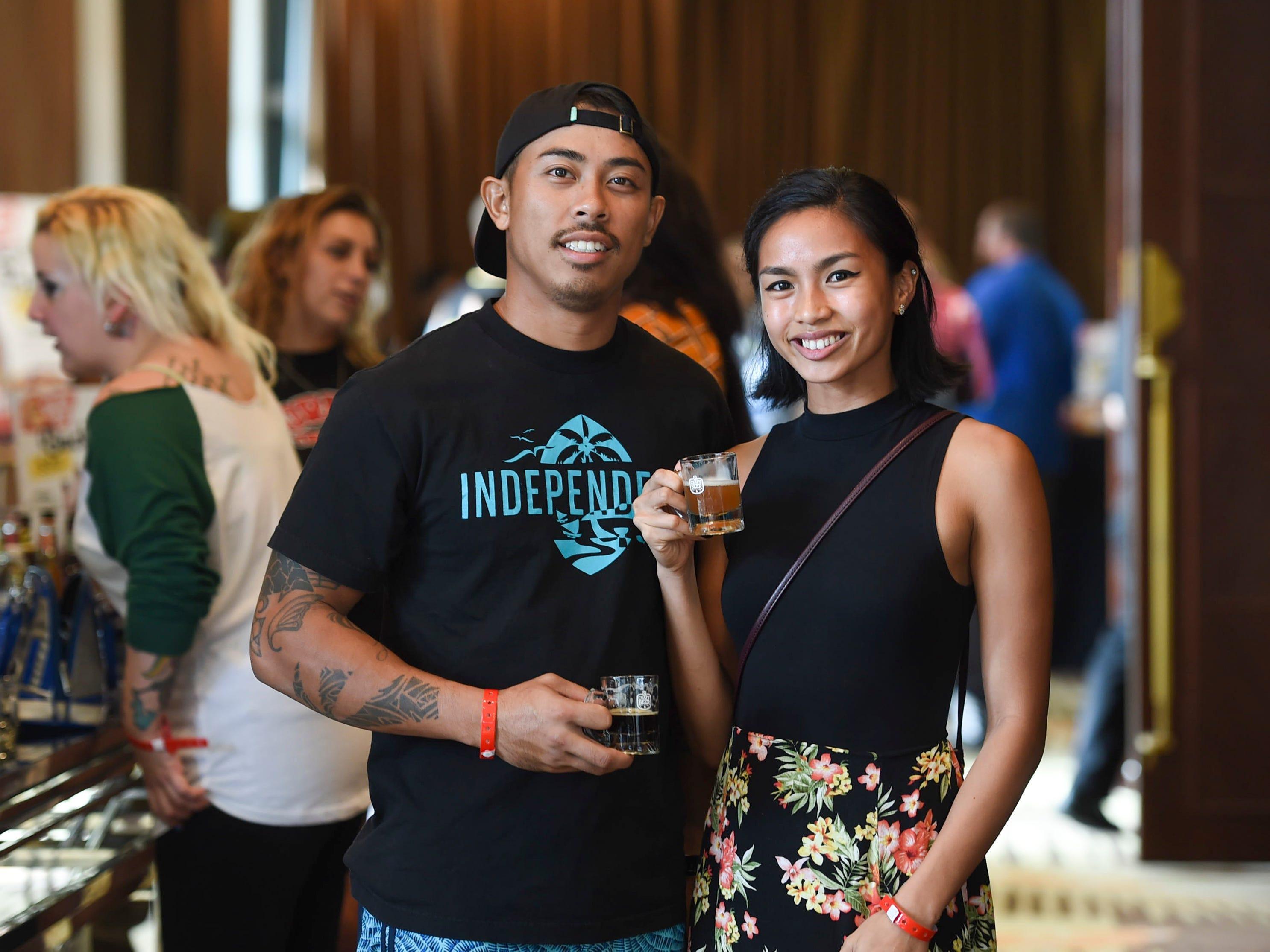 Ykhy Dela Cruz and Josh Carbullido during the Circle K Craft Beer Festival at the Sheraton Laguna Guam Resort, Sept. 29, 2018.
