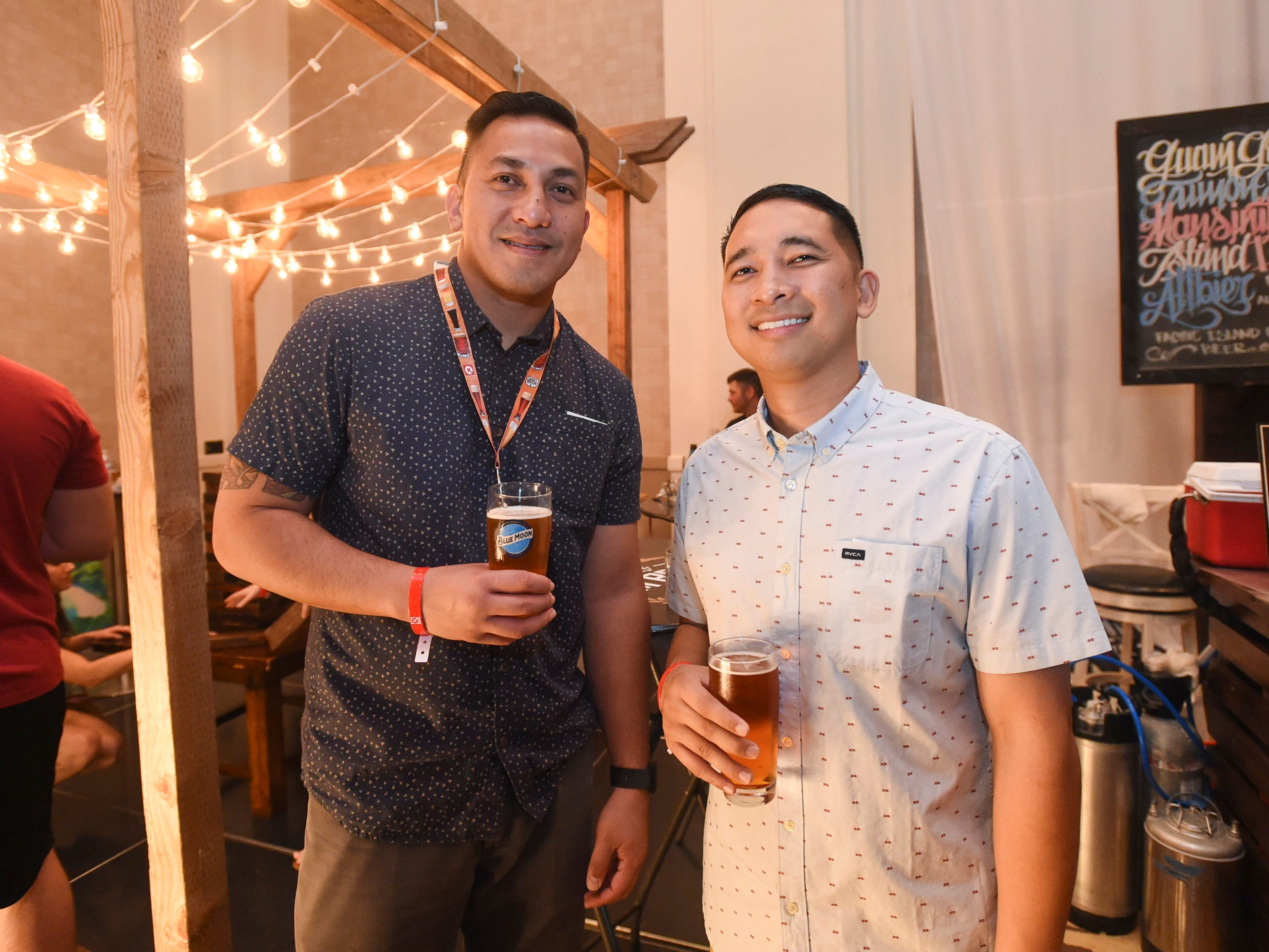 Best friends Ray Serineo, left, and Carlito Reyes, Jr. during the Circle K Craft Beer Festival at the Sheraton Laguna Guam Resort, Sept. 29, 2018.