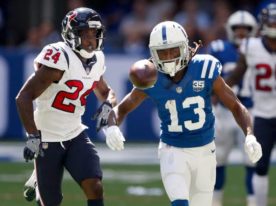 Indianapolis Colts wide receiver T.Y. Hilton (13) could run down this pass by Andrew Luck as Houston Texans defensive back Johnathan Joseph (24) defends in the first half of their game on Sunday, Sept. 30, 2018.