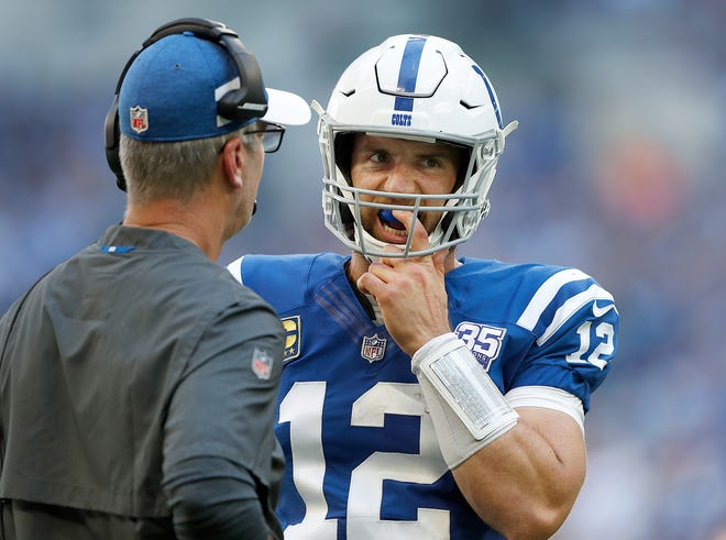 Indianapolis Colts quarterback Andrew Luck (12) talks with head coach Frank Reich in the first half of their game on Sunday, Sept. 30, 2018.