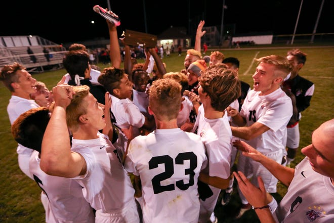 North Central celebrates their 1-0 victory over Pike at the end of the second half of North Central vs. Pike High School Marion County Boys Soccer Championship held at North Central High School, September 29, 2018.