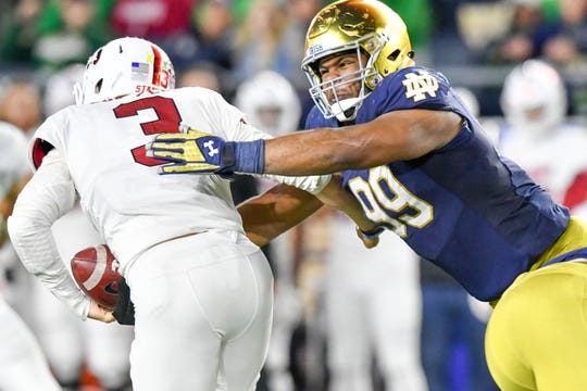 Notre Dame Fighting Irish defensive lineman Jerry Tillery (99) sacks Stanford Cardinal quarterback K.J. Costello (3) in the fourth quarter at Notre Dame Stadium.