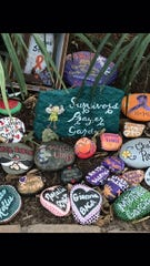 A healing garden near the site of the Las Vegas massacre includes a display of painted rocks with the names of victims and survivors.