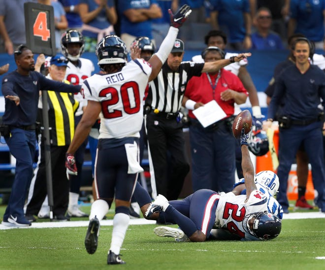 Indianapolis Colts wide receiver Chester Rogers (80) failed to catch this pass that was broken up by Houston Texans defensive back Johnathan Joseph (24) on the Colts final possession in the overtime game on Sunday, Sept. 30, 2018. The Indianapolis Colts lost 37-34 in overtime to the Houston Texans.