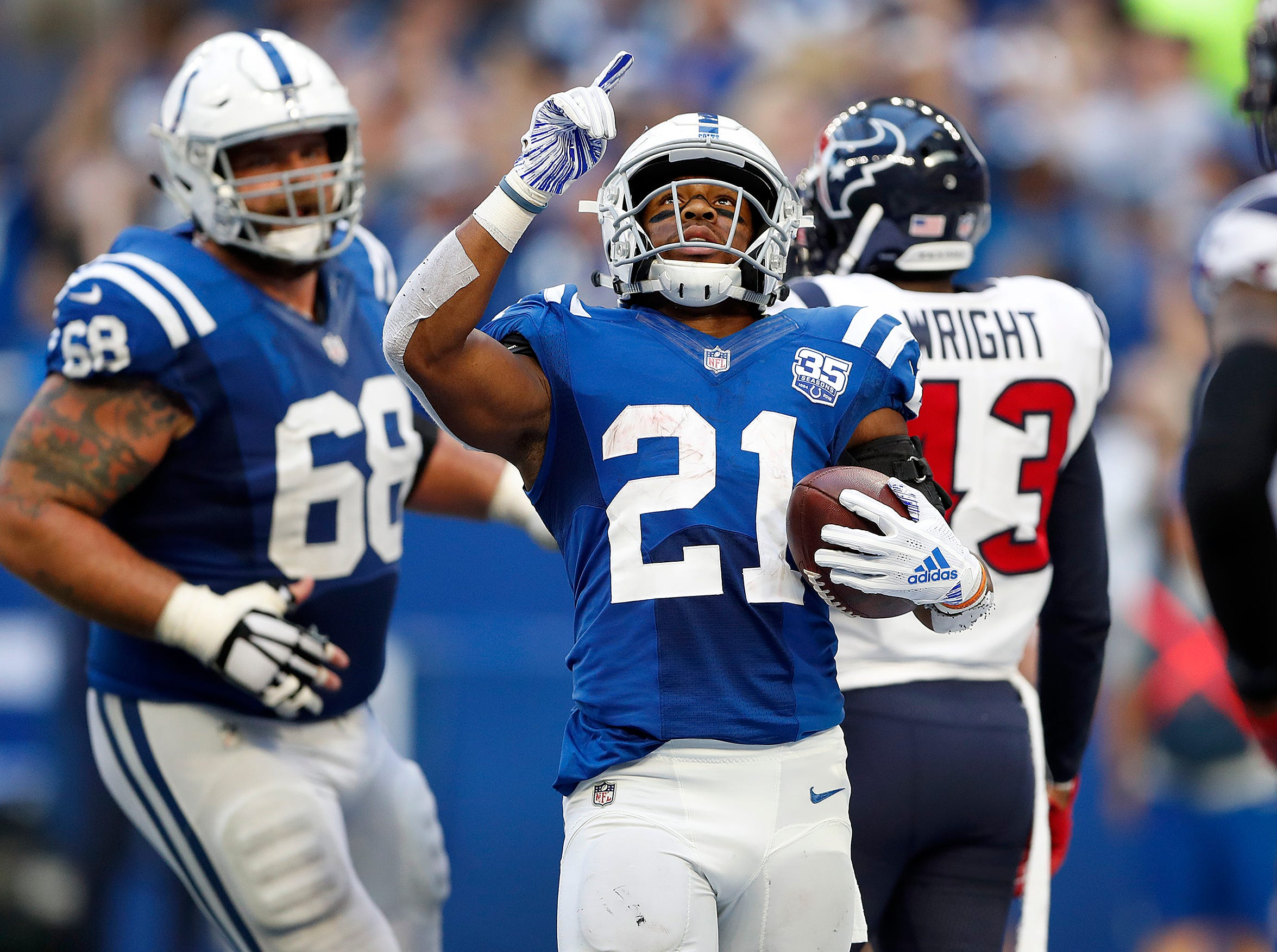 Indianapolis Colts running back Nyheim Hines (21) celebrates his touchdown in the second half of their game on Sunday, Sept. 30, 2018. The Indianapolis Colts lost 37-34 in overtime to the Houston Texans.