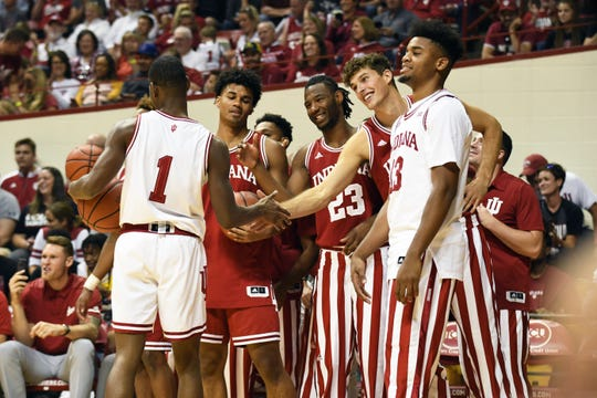 Indiana Hoosiers players congratulate guard Al Durham (1) during Hoosier Hysteria at Simon Skjodt Assembly Hall in Bloomington, Ind., on Saturday, Sept. 29, 2018.