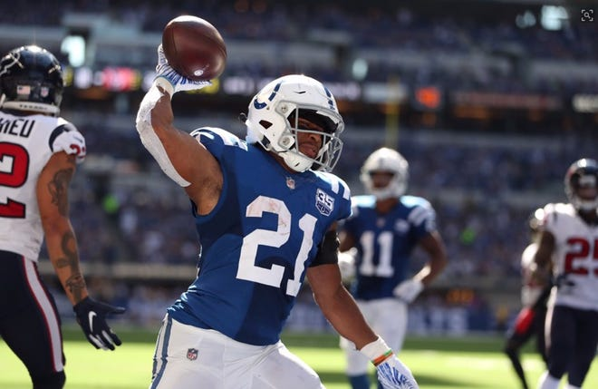 Nyheim Hines celebrates his touchdown for the Indianapolis Colts against the Houston Texans. Sept. 30, 2018