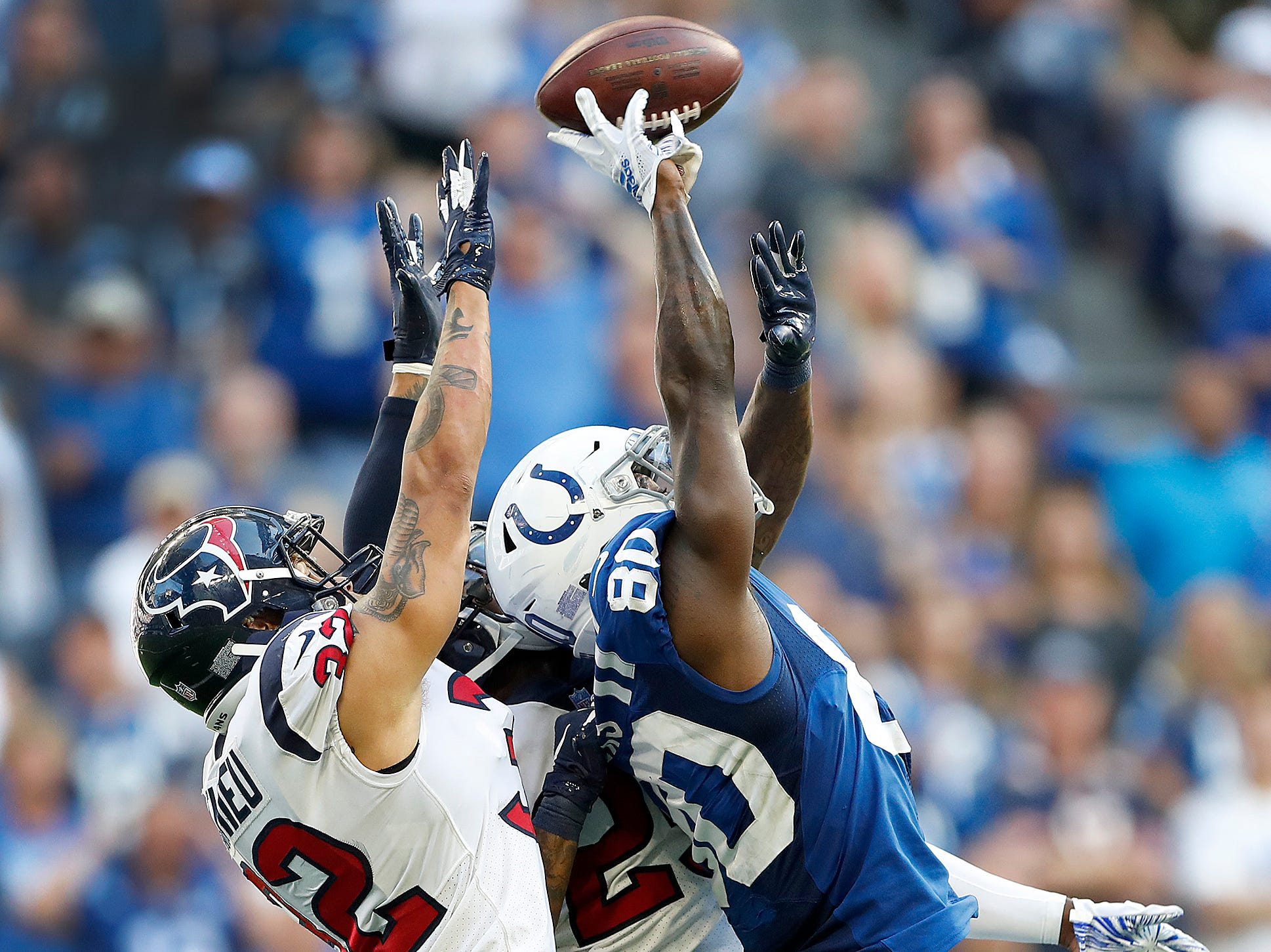 Indianapolis Colts wide receiver Chester Rogers (80) could not come up with this catch as Houston Texans defensive back Tyrann Mathieu (32) defends in the second half of their game on Sunday, Sept. 30, 2018. The Indianapolis Colts lost 37-34 in overtime to the Houston Texans.