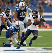 Houston Texans quarterback Deshaun Watson (4) runs away from Indianapolis Colts linebacker Darius Leonard (53) in the second half of their game on Sunday, Sept. 30, 2018. The Indianapolis Colts lost 37-34 in overtime to the Houston Texans.