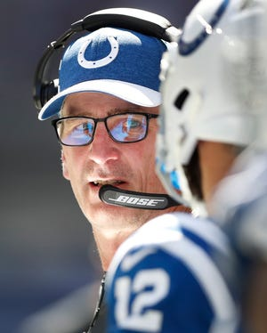 Indianapolis Colts head coach Frank Reich talks to his quarterback Andrew Luck on the sidelines in the first half of their game on Sunday, Sept. 30, 2018.