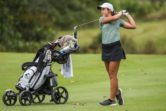 Evansville North's Reagan Sohn drives to the 18th green during IHSAA girls state golf finals at Prairie View Golf Club in Carmel, Ind., Saturday, Sept. 29, 2018.