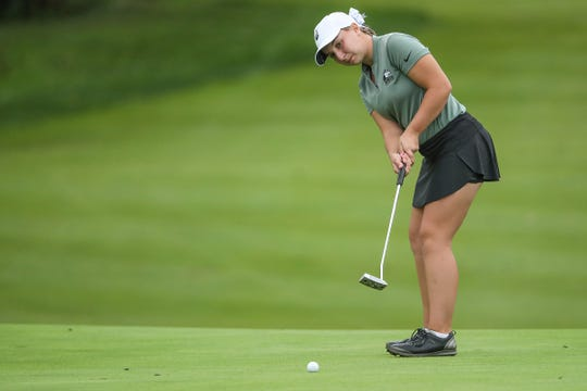 Evansville North's Katelyn Skinner putts to the 18th hole as the Huskies take the overall title for IHSAA girls state golf finals at Prairie View Golf Club in Carmel, Ind., Saturday, Sept. 29, 2018.