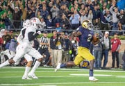 Sep 29, 2018; South Bend, IN, USA; Notre Dame Fighting Irish running back Dexter Williams (2) runs for a touchdown in the first quarter against the Stanford Cardinal at Notre Dame Stadium. Mandatory Credit: Matt Cashore-USA TODAY Sports