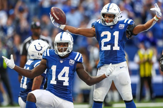 Indianapolis Colts running back Nyheim Hines (21) celebrates a touchdown with teammate and wide receiver Zach Pascal (14) against the Houston Texans at Lucas Oil Stadium on Sunday, Sept. 30, 2018.