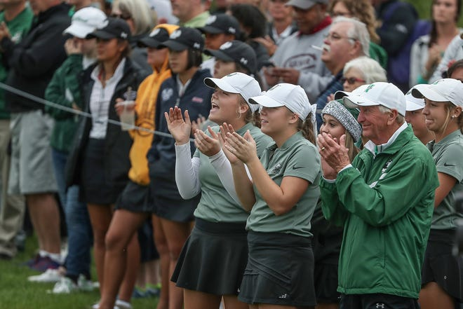 North High School celebrates at Prairie View Golf Club last September before winning another state championship. The Huskies return six of their top seven players.