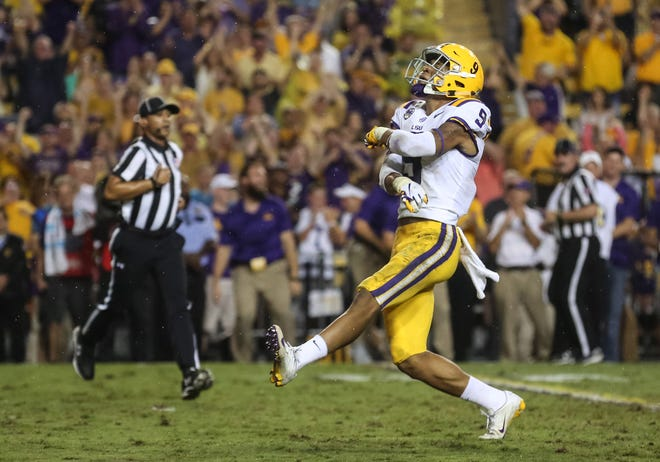 Sep 29, 2018; Baton Rouge, LA, USA; LSU Tigers safety Grant Delpit (9) celebrates after sacking Ole Miss Rebels quarterback Jordan Ta'amu (not pictured) during the first quarter of a game at Tiger Stadium. Mandatory Credit: Derick E. Hingle-USA TODAY Sports