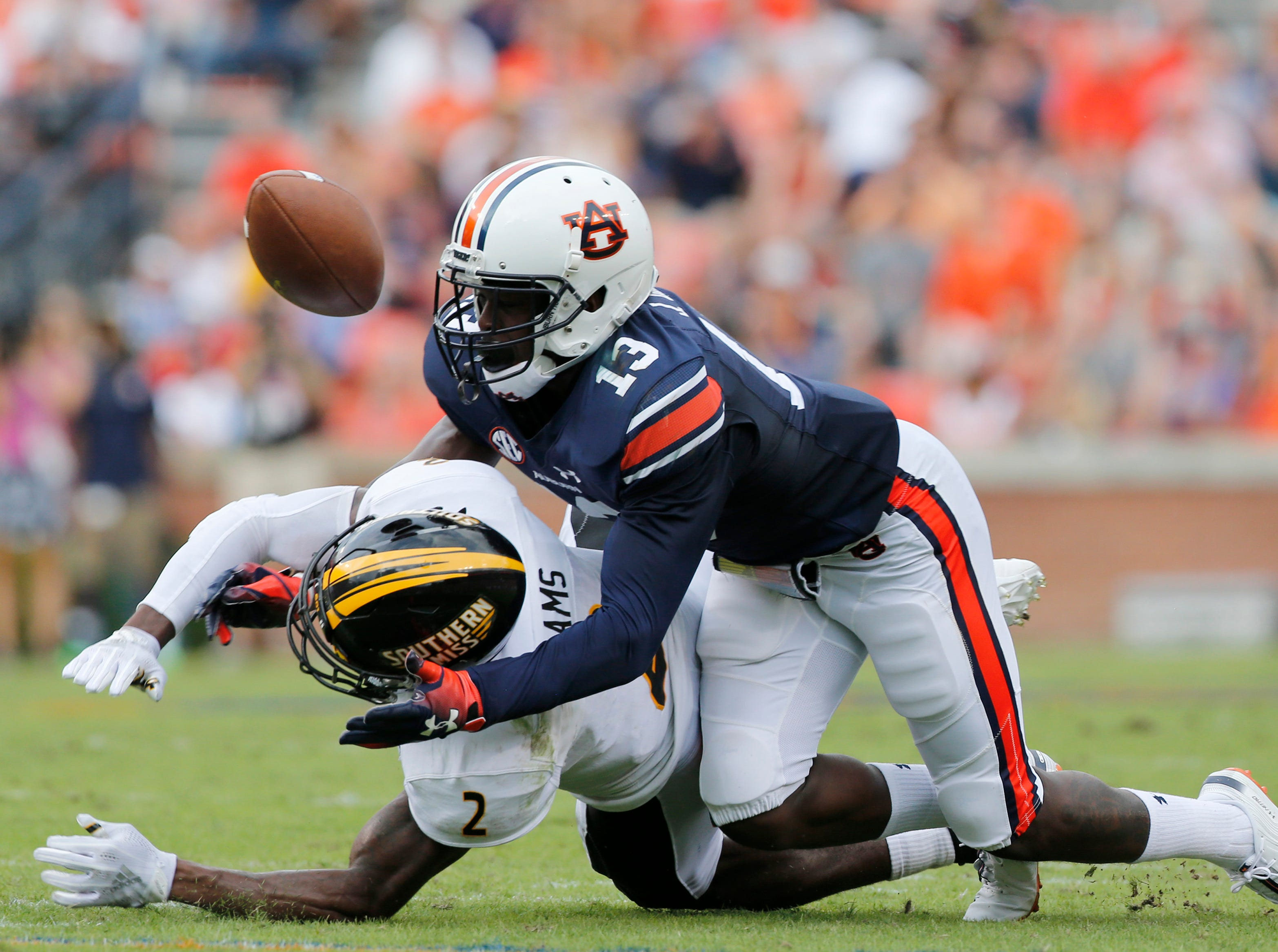Sep 29, 2018; Auburn, AL, USA; Auburn Tigers defensive back Javaris Davis (13) breaks up a pass intended for Southern Miss Golden Eagles receiver Jaylond Adams (2) during the first quarter at Jordan-Hare Stadium. Mandatory Credit: John Reed-USA TODAY Sports