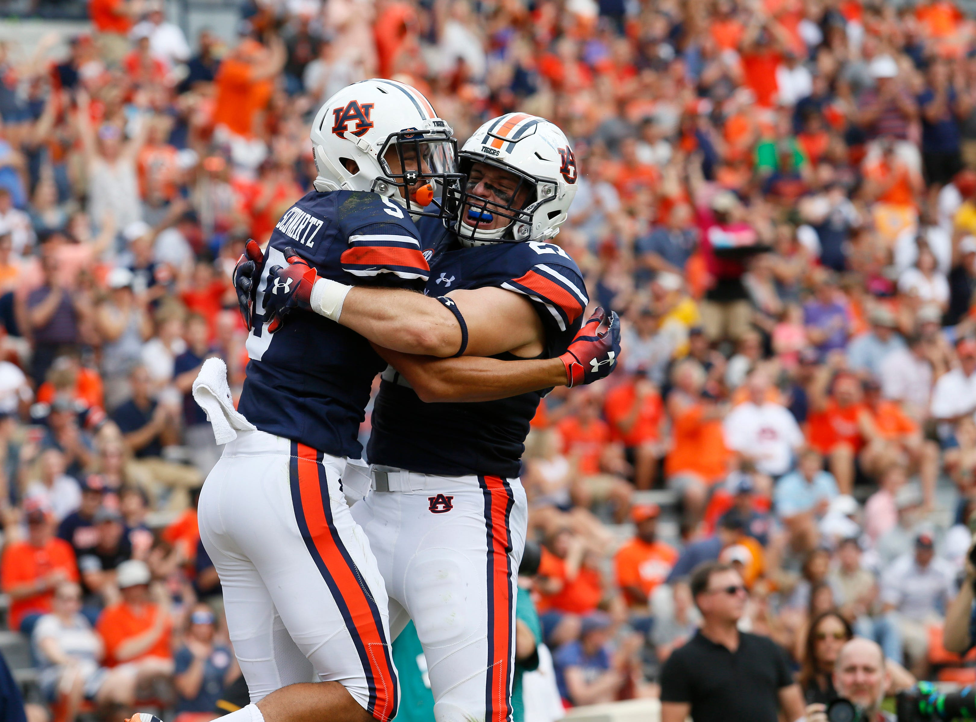 Sep 29, 2018; Auburn, AL, USA; Auburn Tigers receiver Anthony Schwartz (5) celebrates with fullback Chandler Cox (27) after scoring a touchdown against the Southern Miss Golden Eagles during the second quarter at Jordan-Hare Stadium. Mandatory Credit: John Reed-USA TODAY Sports