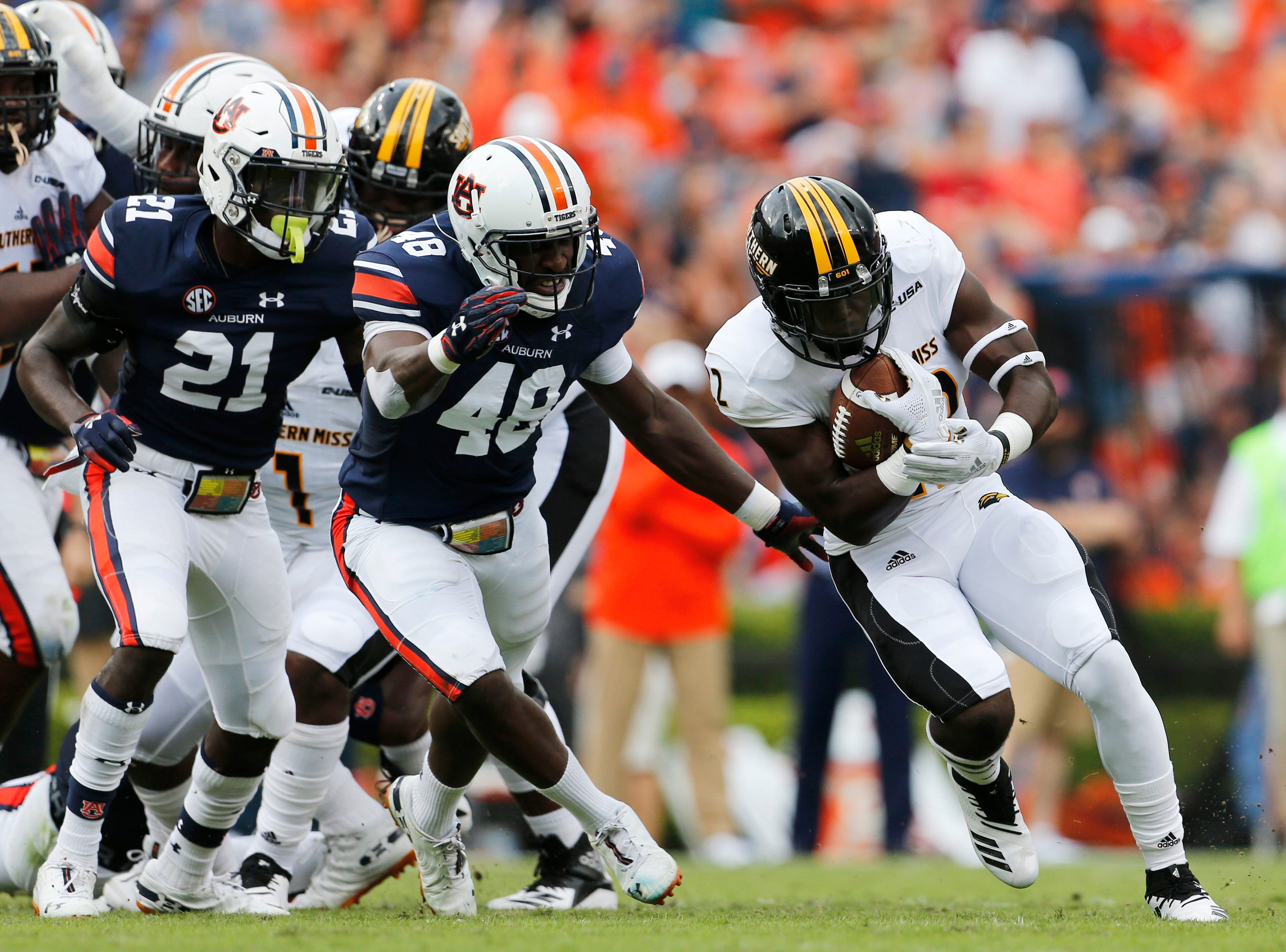 Sep 29, 2018; Auburn, AL, USA; Southern Miss Golden Eagles running back Trivenskey Mosley (22) is chased by Auburn Tigers defensive back Smoke Monday (21) and Montavious Atkinson (48) during the first quarter at Jordan-Hare Stadium. Mandatory Credit: John Reed-USA TODAY Sports