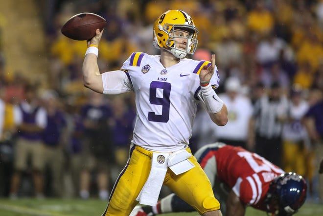 Sep 29, 2018; Baton Rouge, LA, USA; LSU Tigers quarterback Joe Burrow (9) passes against the Ole Miss Rebels during the second quarter of a game at Tiger Stadium. Mandatory Credit: Derick E. Hingle-USA TODAY Sports
