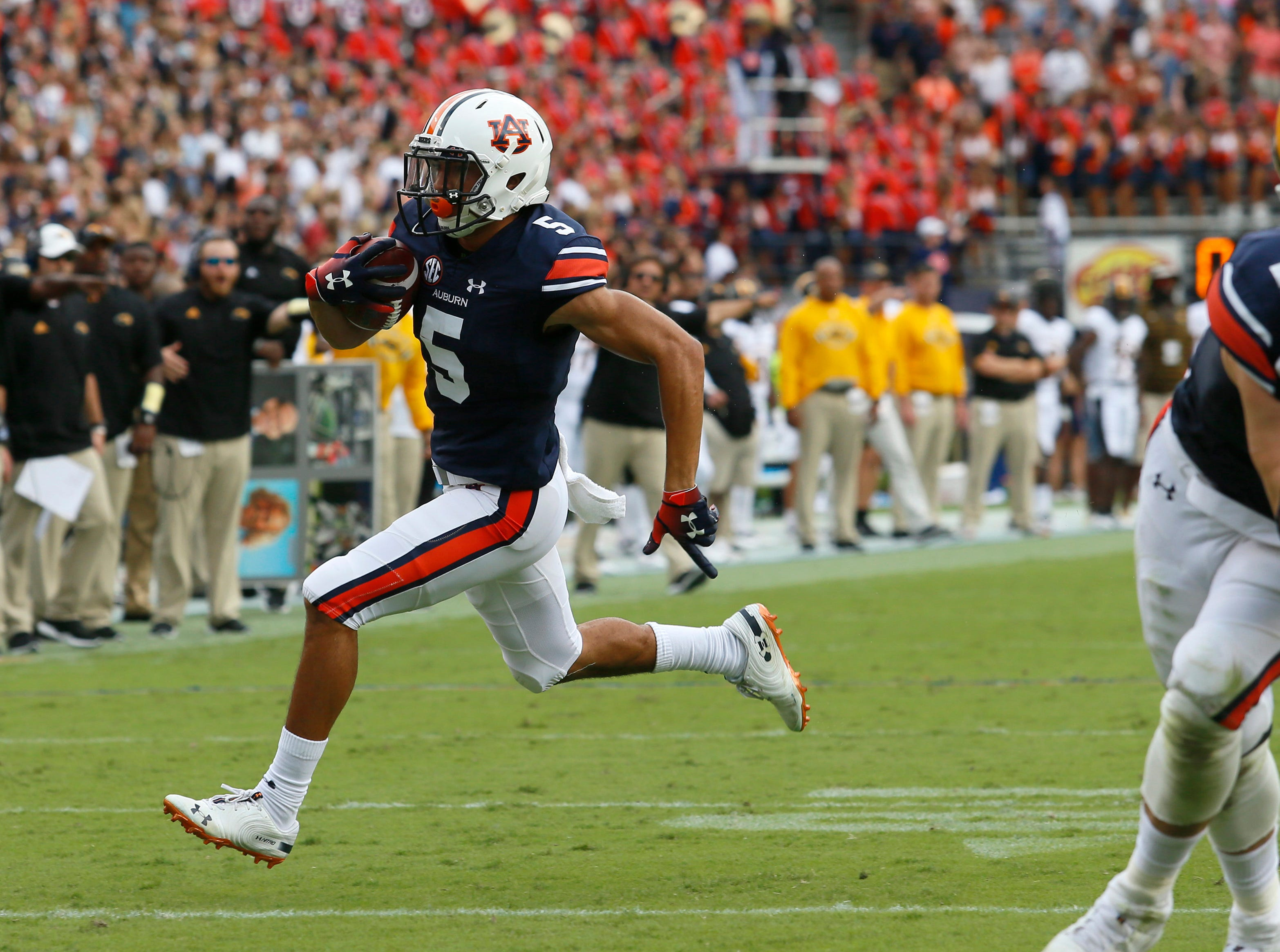 Sep 29, 2018; Auburn, AL, USA; Auburn Tigers receiver Anthony Schwartz (5) scores a touchdown against the Southern Miss Golden Eagles during the second quarter at Jordan-Hare Stadium. Mandatory Credit: John Reed-USA TODAY Sports