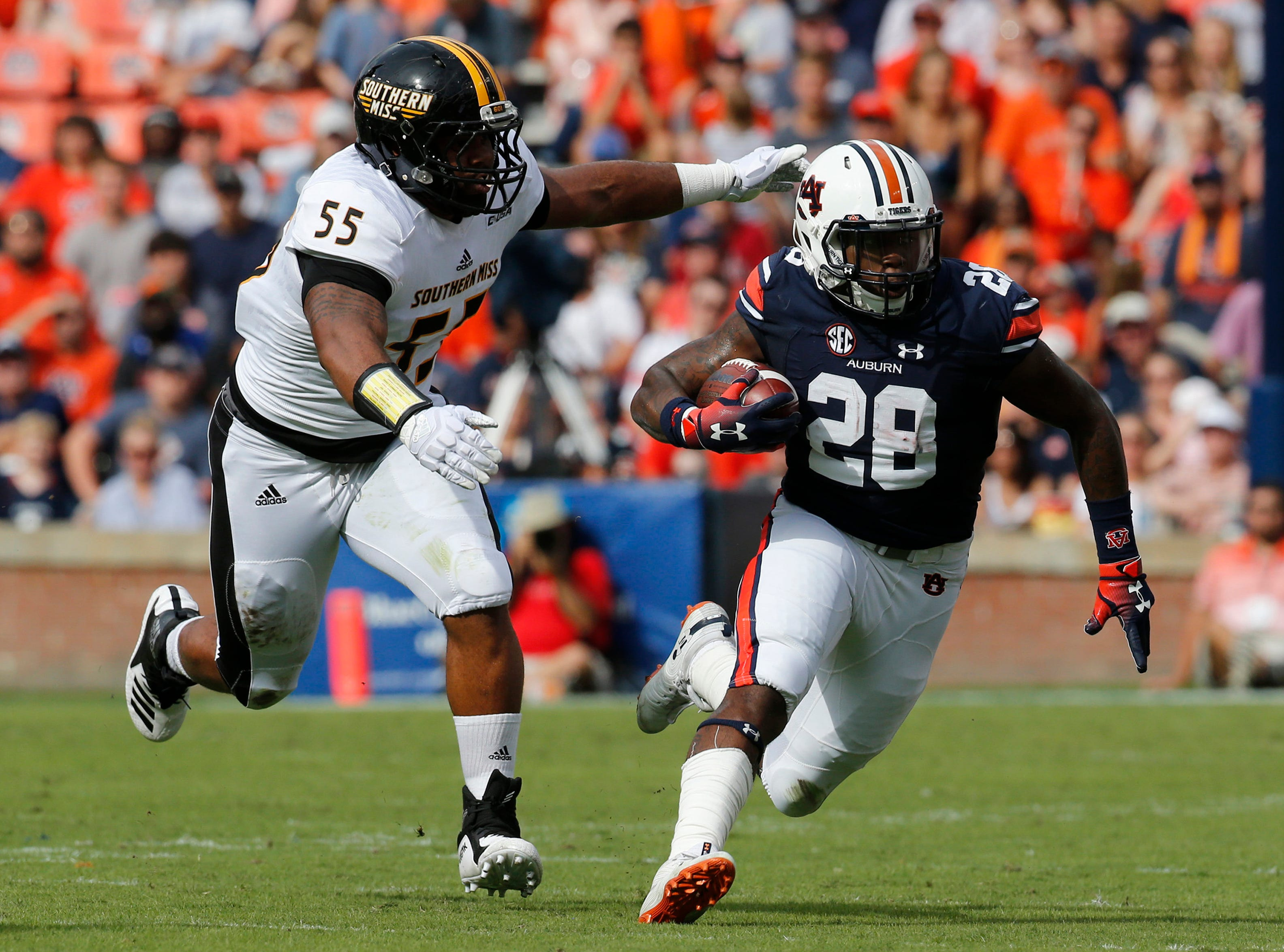 Sep 29, 2018; Auburn, AL, USA; Southern Miss Golden Eagles lineman Demarrio Smith (55) chases down Auburn Tigers running back JaTarvious Whitlow (28) during the first quarter at Jordan-Hare Stadium. Mandatory Credit: John Reed-USA TODAY Sports