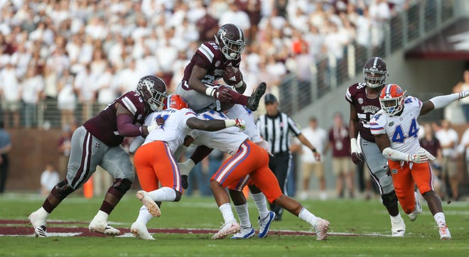 Mississippi State's Aeris Williams (26) goes high in the air on a run in the first quarter. Mississippi State and Florida played in an SEC college football game on Saturday, September 29, 2018, in Starkville. Photo by Keith Warren/Madatory Photo Credit