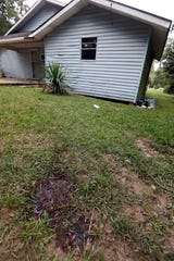 A blood stain on the lawn by a duplex where two Brookhaven policemen were killed Saturday morning, 2018, remains Sunday afternoon, Sept. 30, 2018, in Brookhaven, Miss.