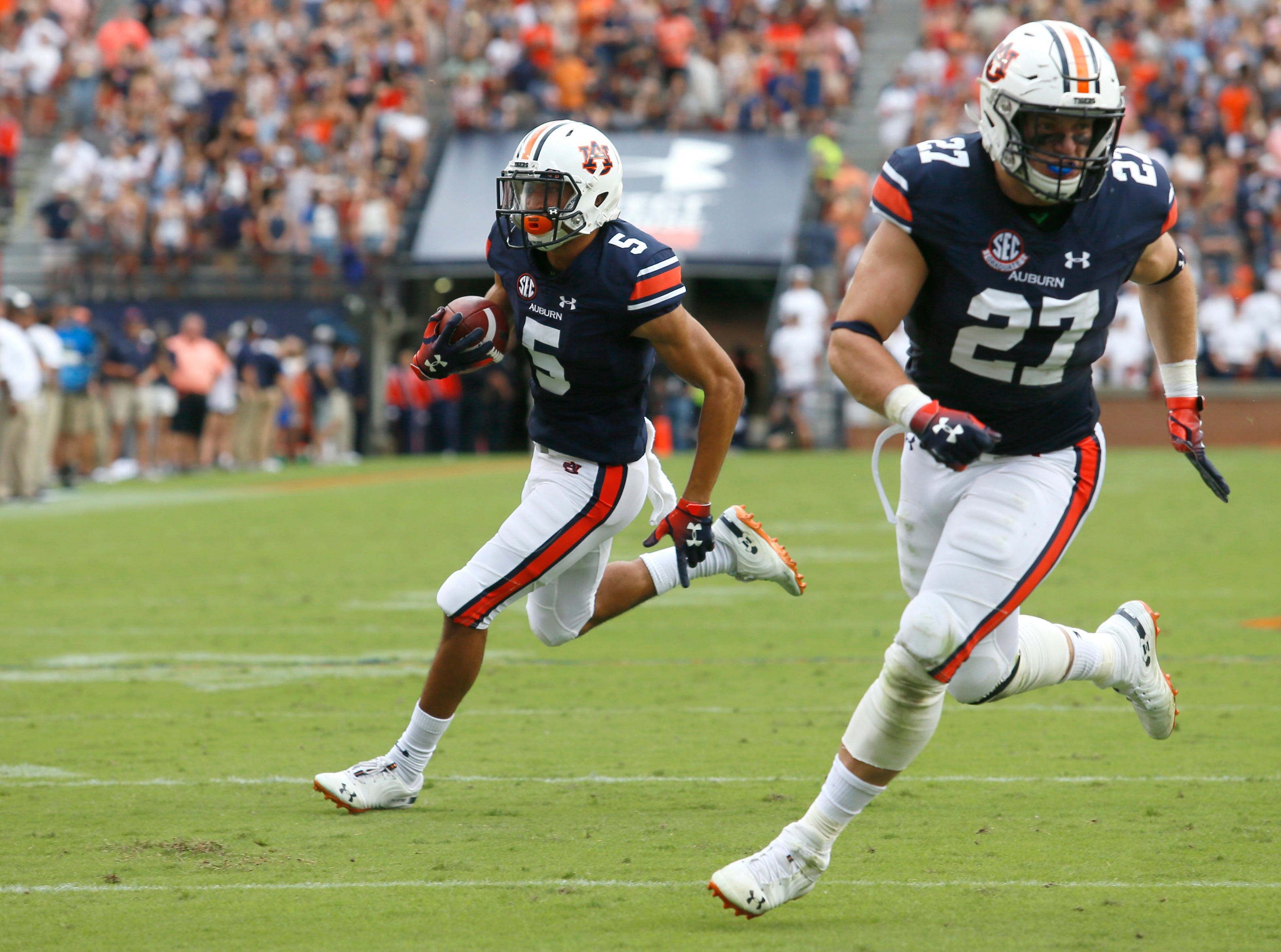 Sep 29, 2018; Auburn, AL, USA; Auburn Tigers receiver Anthony Schwartz (5) runs behind fullback Chandler Cox (27) and scores a touchdown against the Southern Miss Golden Eagles during the second quarter at Jordan-Hare Stadium. Mandatory Credit: John Reed-USA TODAY Sports