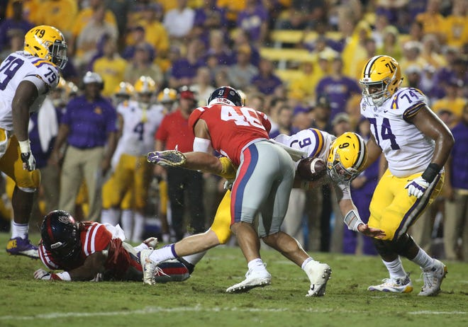 Sep 29, 2018; Baton Rouge, LA, USA; Ole Miss Rebels linebacker Mohamed Sanogo (46) forces a fumble against the LSU Tigers during the second quarter of a game at Tiger Stadium. Mandatory Credit: Derick E. Hingle-USA TODAY Sports