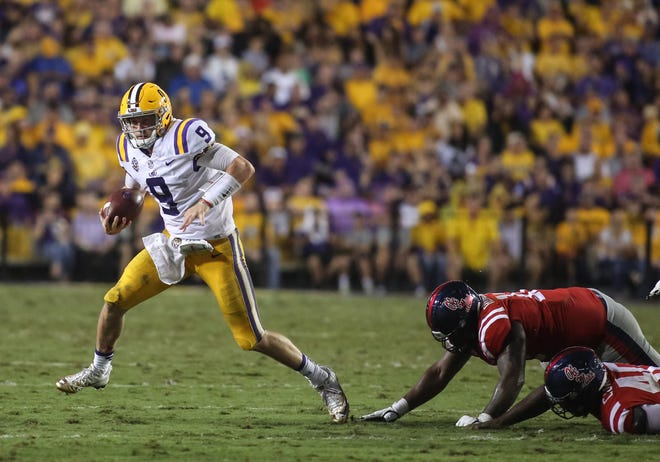 Sep 29, 2018; Baton Rouge, LA, USA; LSU Tigers quarterback Joe Burrow (9) runs against the Ole Miss Rebels during the second quarter of a game at Tiger Stadium. Mandatory Credit: Derick E. Hingle-USA TODAY Sports