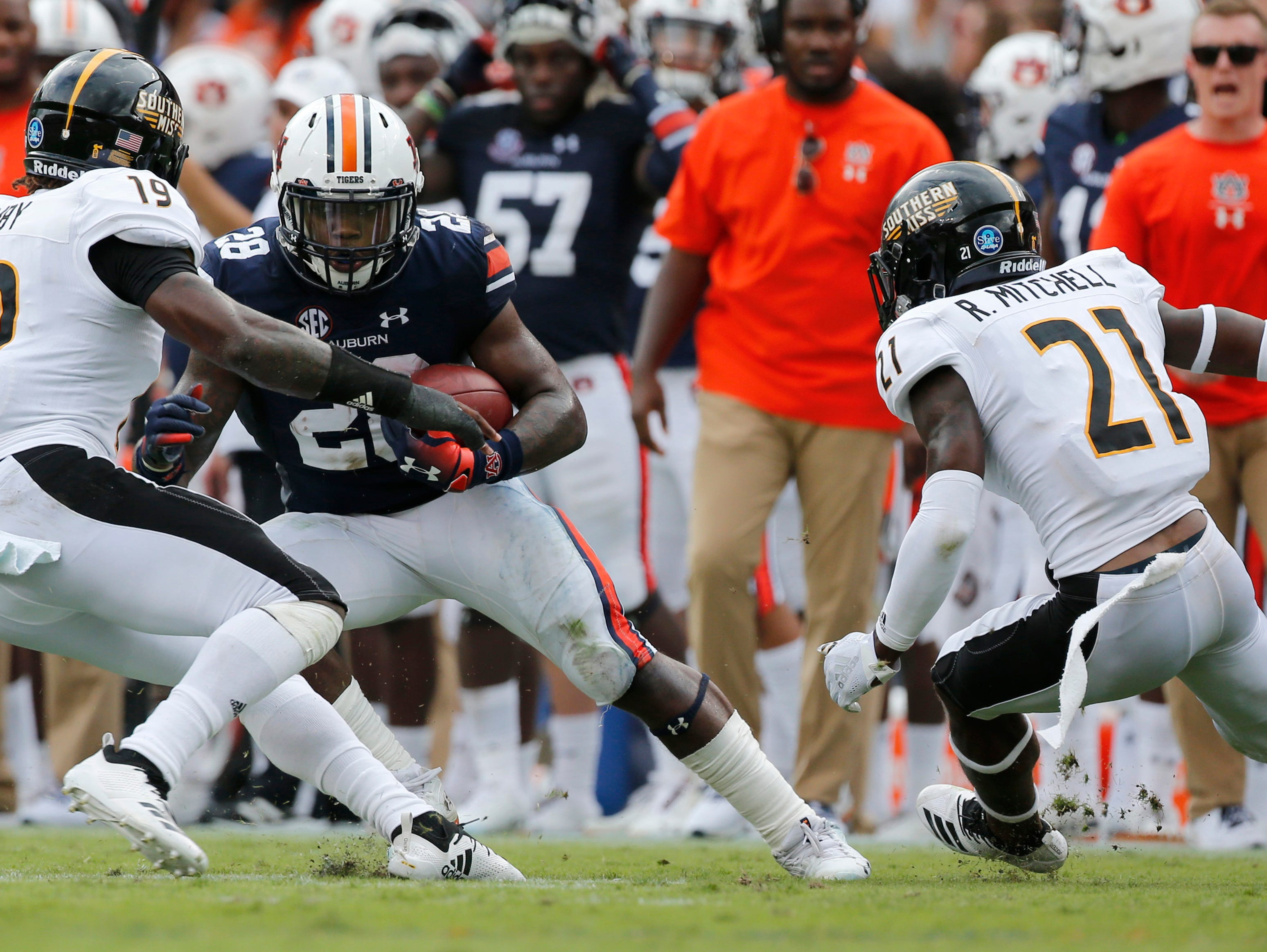 Sep 29, 2018; Auburn, AL, USA; Southern Miss Golden Eagles defensive backs Ku'el Hemby (19) and Rachaun Mitchell (21) close in on Auburn Tigers running back JaTarvious Willaims (28) during the second quarter at Jordan-Hare Stadium. Mandatory Credit: John Reed-USA TODAY Sports